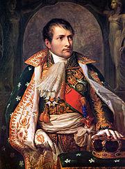 Napoleonas Bonapartas - Prancūzijos revoliucinės armijos generolas, nuo 1799 m. tapęs Prancūzijos valdovu (Pirmuoju Konsulu), vėliau – imperatoriumi.